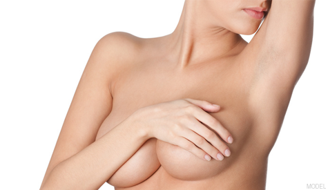 Woman Covering Breasts With Hand